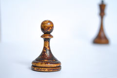 Old chess Board with wooden pieces on a white background Stock Photos