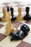 Old chess on old paper board. Old glazed chess on old paper board Stock Photos