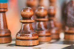 Old Chess Pawn Standing On Wooden Chessboard Stock Photos