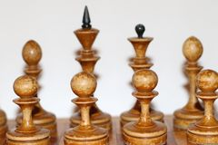 Old chess pieces on the board stock photos