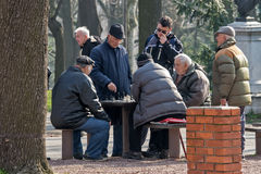Old chess players in park 3 Stock Photos
