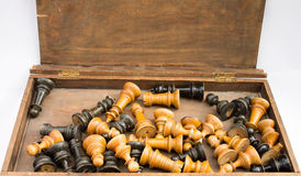 Old chess set in an wooden box Royalty Free Stock Image