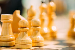 Old Chess Standing On Chessboard Royalty Free Stock Photography