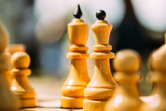 Old Chess Standing On Chessboard Royalty Free Stock Photos