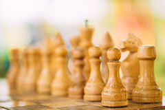 Old Chess Standing On Chessboard Royalty Free Stock Images