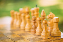Old Chess Standing On Chessboard Royalty Free Stock Image