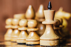 Old Chess Standing On Wooden Chessboard Royalty Free Stock Photography