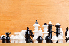 Old chess on wooden background Stock Photo
