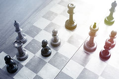 Old chess. Old wooden chess  pieces on a chess board Stock Images
