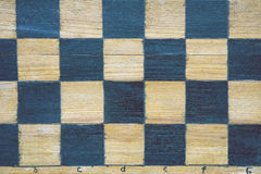 Old chessboard fragment Stock Photo