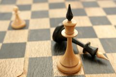 Old chessmen. On the crackled chessboard background Stock Photo