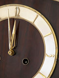 Old chessnut clock ivory dial Royalty Free Stock Images