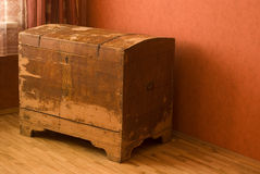 Old chest. Old wood chest in the red chamber Royalty Free Stock Images