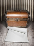 Old chest and blank paper Stock Image