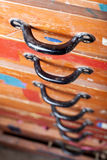 Old chest of drawers with black handles Royalty Free Stock Photos