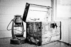 Old chest and lantern in black and white Stock Images