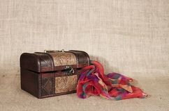 Old chest and scarf Stock Images