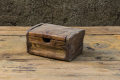 Old chest on wooden table still life Stock Photos