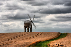 The old Chesterton Windmill under a moody cloudy sky. Chesterton Windmill under a moody cloudy sky Stock Photos