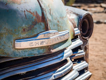 Old Chevrolet car wreck left in Solitaire on the Namib Desert, N. Amibia Stock Photo