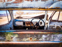 Old Chevrolet car wreck left in Solitaire on the Namib Desert, N. SOLITAIRE, NAMIBIA - JUNE 18, 2016: Old Ford car wreck left in Solitaire on the Namib Desert Stock Image