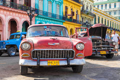 Old Chevrolet near colorful buildings in Havana Stock Photography