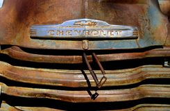 Old Chevrolet pickup with a hood logo. HAWLEY, MINNESOTA, August 22, 2017: The old pickup from the 40`s or 50`s with the hood logo, is a Chevrolet or GMC Stock Images