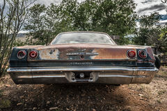 Old Chevrolet wreck left abandoned on the historic Route 66 in Arizona. HACKBERRY, ARIZONA, USA - MAY 19, 2016 : Old Chevrolet wreck left abandoned near the Royalty Free Stock Photo