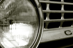 Old Chevy. Close-up of a Chevy headlight and grill royalty free stock images