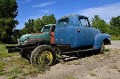 Old Chevy or GMC pickips. HAWLEY, MINNESOTA, August 22, 2017: The old pickups from the 40`s or 50`s, are Chevrolets or GMC`s, colloquially referred to as Chevy Stock Image