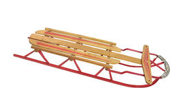 Old child snow sled isolated. Old wooden child snow sled with metal frame and runners.  Isolated on white Royalty Free Stock Photo