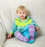 Old child on sofa royalty free stock photos
