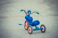 Old childhood tricycle Royalty Free Stock Photo