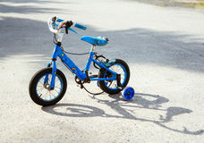 Old children`s bicycle. Old blue bicycle tricycle. Morally old Stock Photography