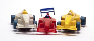 Old children`s racing car on a white background. /old race car/isolated objects,toys Royalty Free Stock Photos