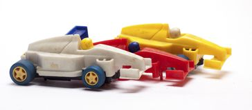 Old children`s racing car on a white background. /old race car/isolated objects,toys Royalty Free Stock Image