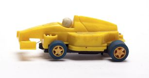 Old children`s racing car on a white background. /old race car/isolated objects,toys Royalty Free Stock Photography