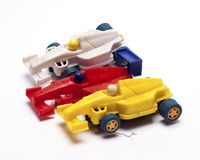 Old children`s racing car on a white background. /old race car/isolated objects,toys Stock Image