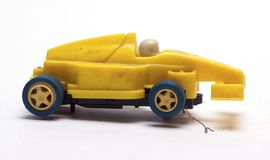 Old children`s racing car on a white background. /old race car/isolated objects,toys Stock Photo