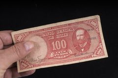 An old Chilean banknote. A old 100 escudos banknote of Chile on the hand Royalty Free Stock Photo