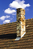 Old chimney. Detail of old chimney and blue sky Stock Photography