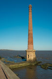 Old chimney. Old industrial chimney on the Rio de la Plata promenade in Montevideo, Uruguay Stock Photography