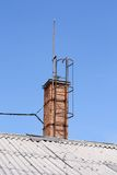 Old chimney and ladder on the roof Royalty Free Stock Images