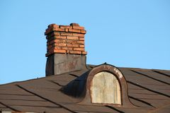 Free Old Chimney On A House Roof Stock Photo - 167800880