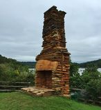 An Old Chimney standing by a river Stock Photos