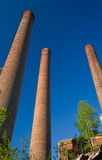 Old chimneys. Three old chimneys in an abandoned cement mill Stock Photography