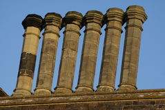 Old chimneys. chimney pots and chimney stacks Stock Photo