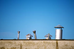 Old chimneys on rooftop Stock Image