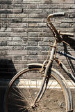 Old Chinese bike against brick wall Stock Photo