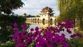 Old chinese bridge and bougainvillea. Jianshui, Yunnan, China royalty free stock images